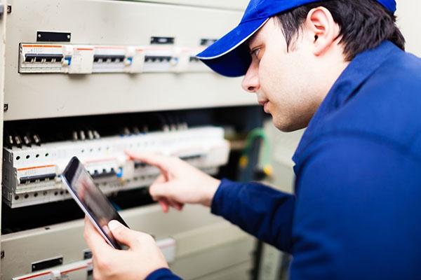 Maintenance man checking equipment