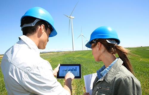 workers_looking_at_tablet_near_windmillsmall.jpg